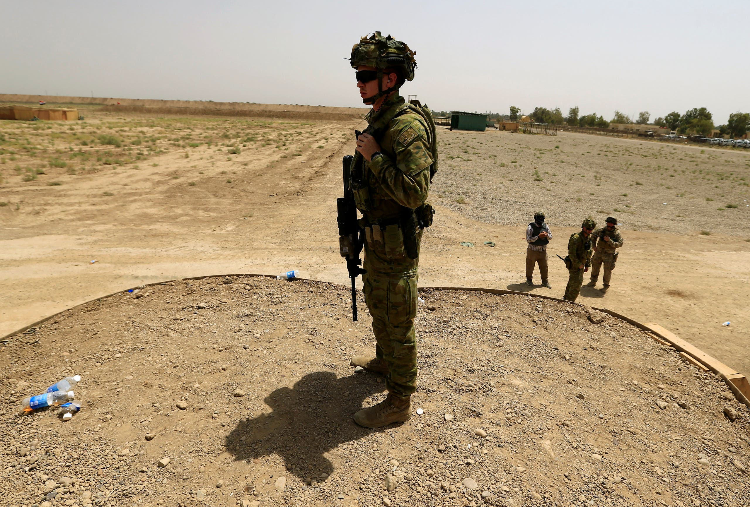 Coalition forces instructors monitor as they train Iraqi Army's 53rd Brigade in a live ammunition training exercise at Taji military base north of Baghdad, Iraq, on August 9, 2017. (Reuters)