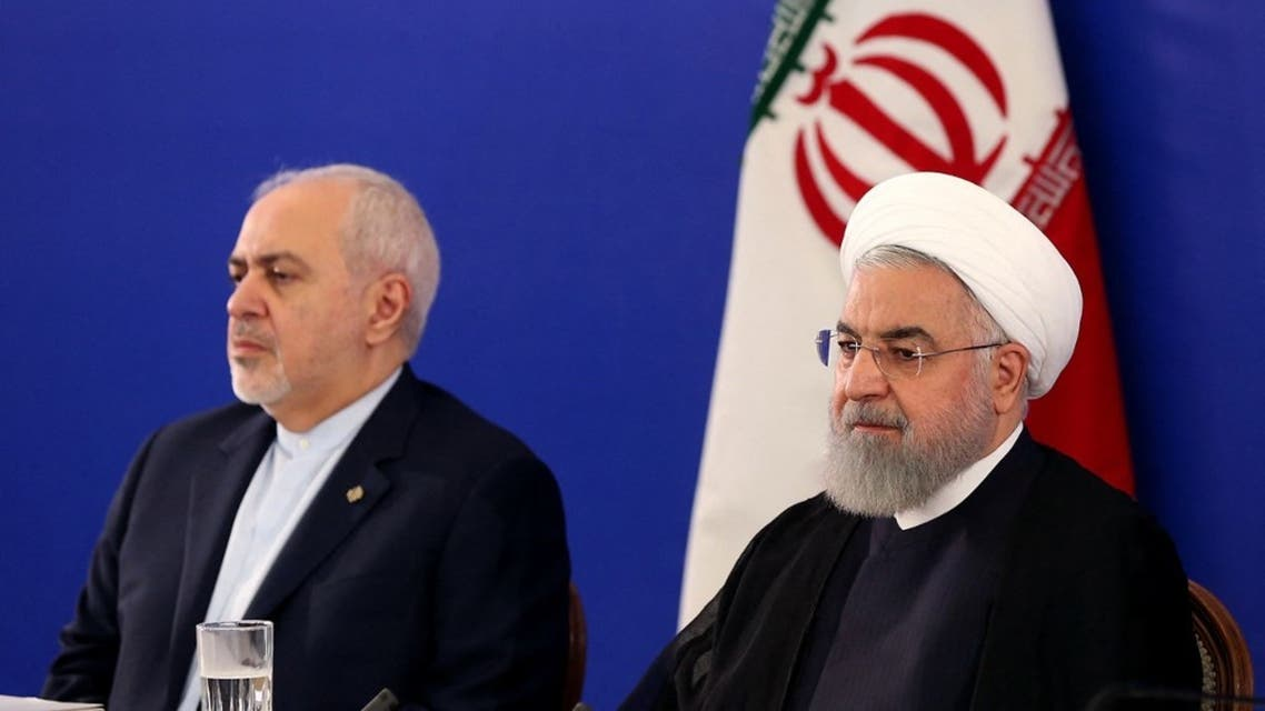 A handout picture provided by the Iranian presidency shows President Hassan Rouhani (R) and his top diplomat, Mohammad Javad Zarif, in Tehran on August 6, 2019. (AFP)