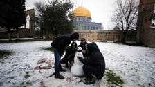 Snow in the Middle East: Jerusalem's holy sites appear under a layer of white