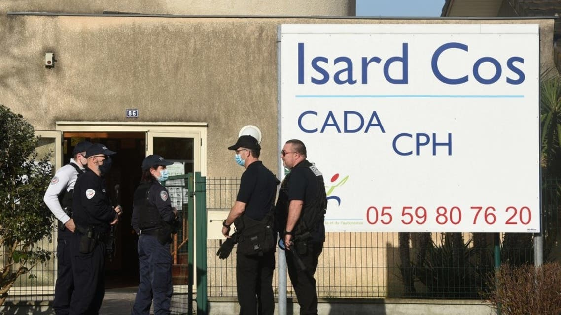 Police officers stand at the entrance of the Isard COS Reception Centre for Asylum Seekers (CADA) in Pau, where a manager has been stabbed to death by an asylum seeker in Pau, southwestern france, on February 19, 2021. (AFP)