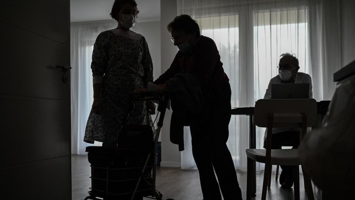 An elderly woman leaves after receiving an injection of a Covid-19 vaccine at a serviced residence for seniors at L'Isle-d'Espagnac on February 16, 2021. (AFP)