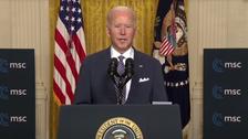 Democracy 'under assault,' Biden says in first message to international community