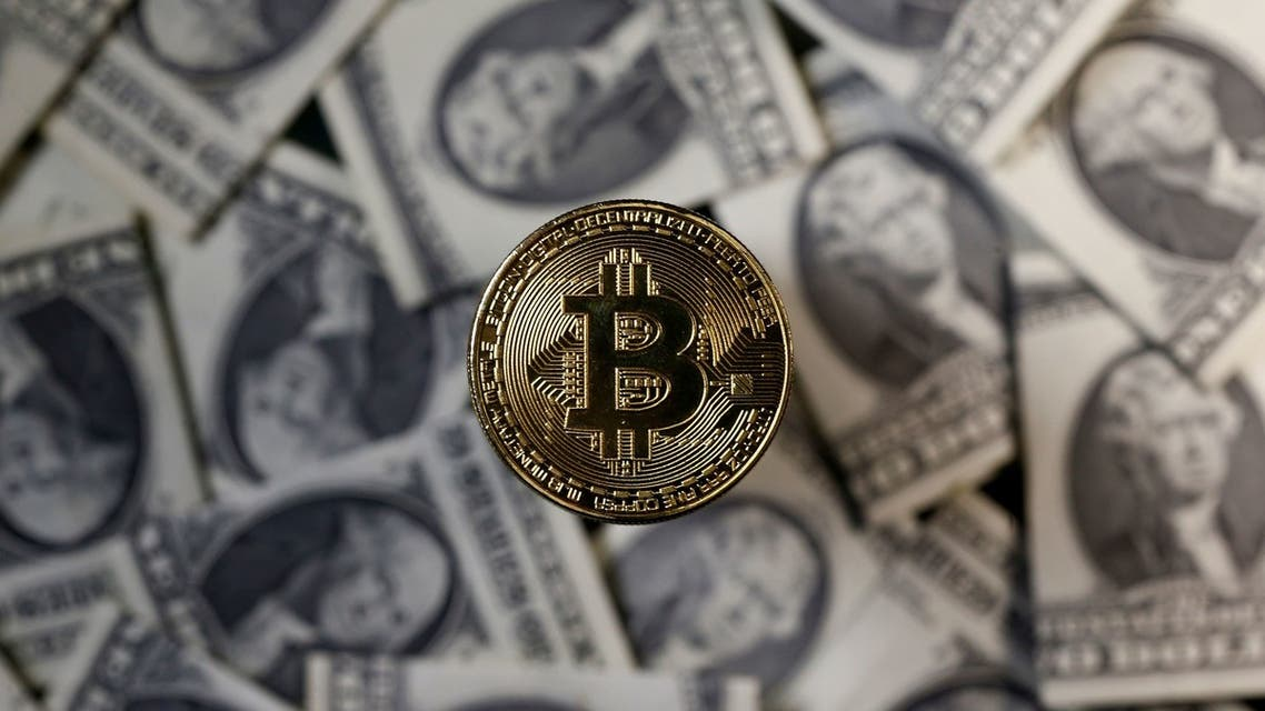 A bitcoin (virtual currency) coin placed on Dollar banknotes is seen in this illustration picture, November 6, 2017. (File photo: Reuters)