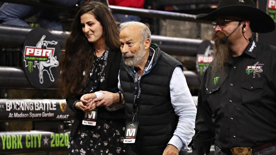 'Charging Bull' artist Arturo Di Modica (C) attends the 2020 Professional Bull Riders Monster Energy Buck Off at the Garden Madison Square Garden on January 4, 2020 in New York City. (Getty Images via AFP)