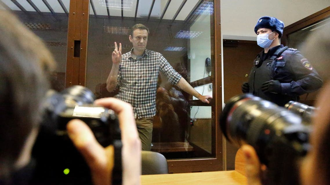 Russian opposition leader Alexei Navalny stands in a cage in the Babuskinsky District Court in Moscow, Russia, Saturday, February 20, 2021. (AP)
