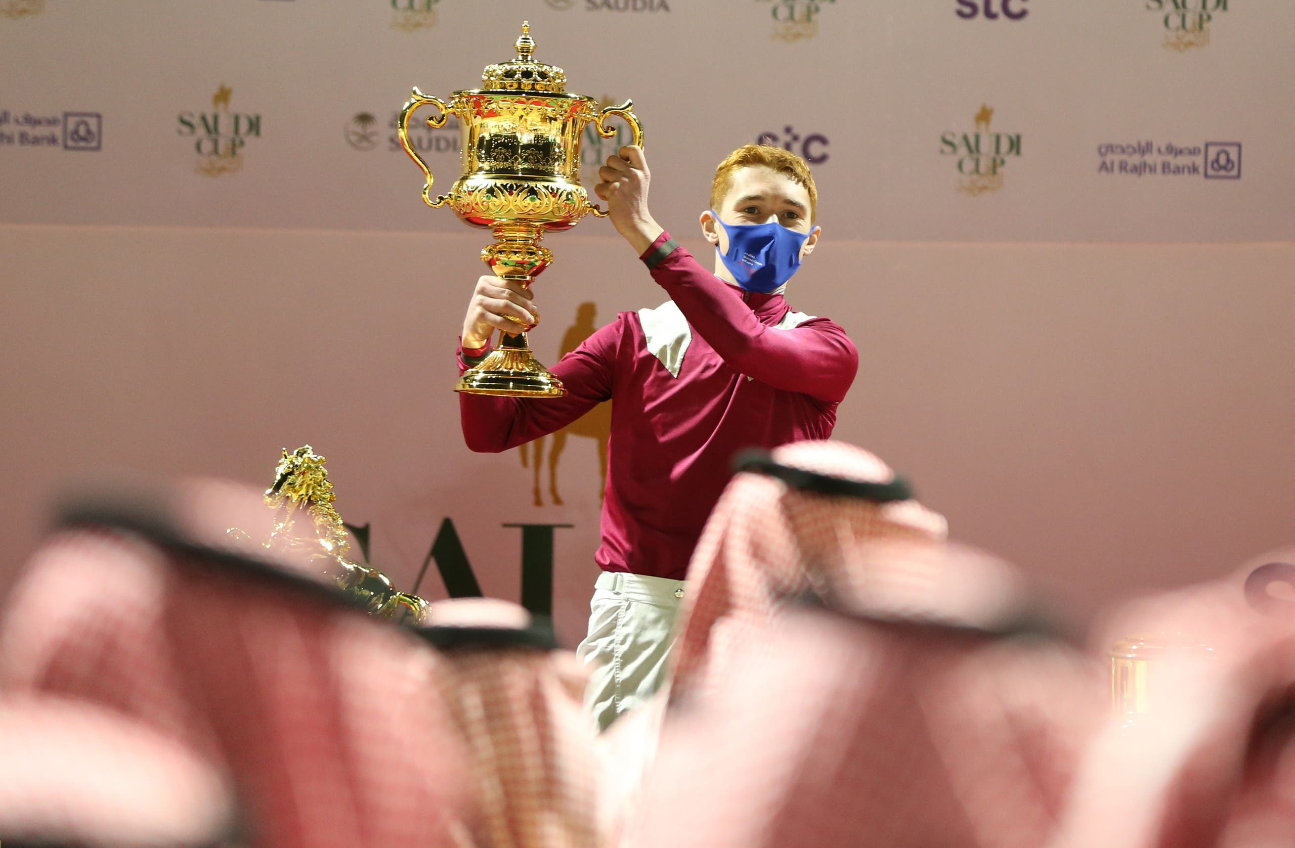 Jockey David Egan celebrates with the trophy after winning the Saudi Cup riding Mishriff. (Reuters)