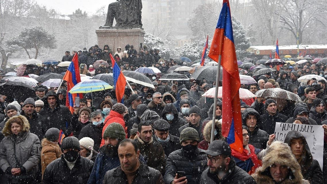 Supporters of opposition Dashnaktsutyun party take part in a rally to demand the resignation of their PM at the Freedom Square in central Yerevan on February 20, 2021. (Karen Minasyan/AFP)