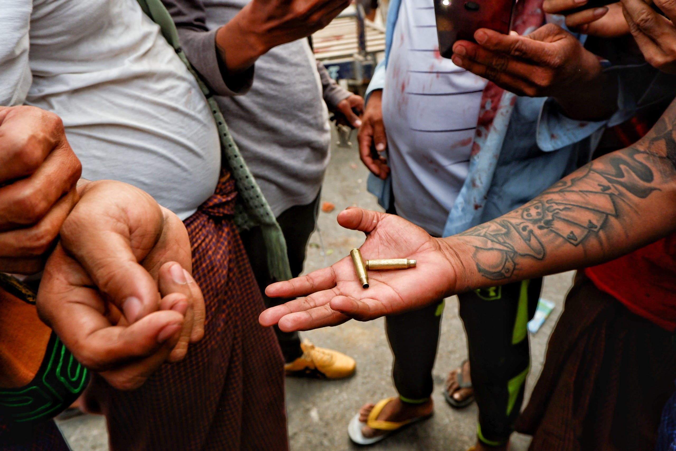 A person shows bullet shells during a protest against the military coup, in Mandalay, Myanmar, February 20, 2021. (Reuters)