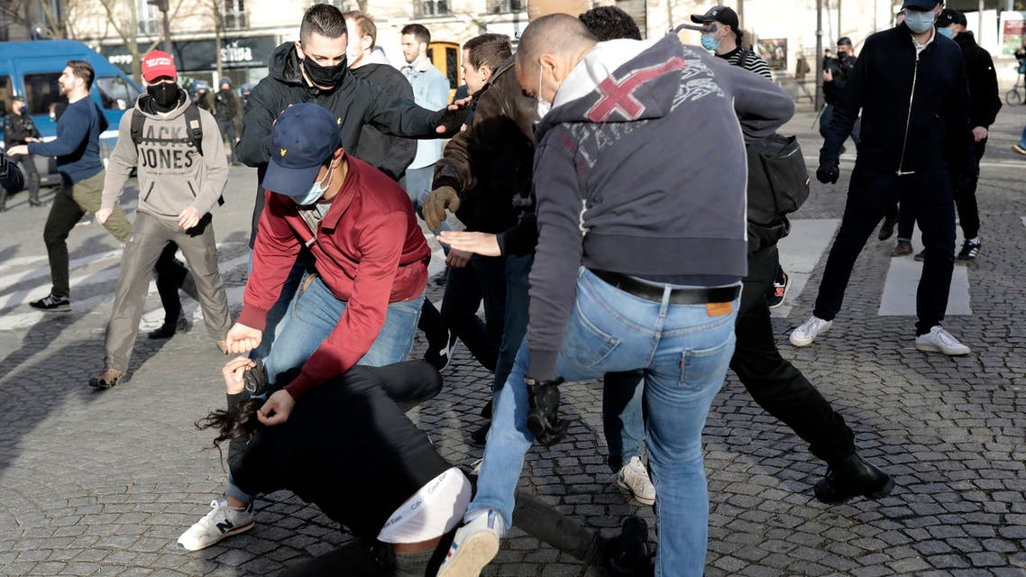 Supporters of the movement Generation Identity clash with an anti fascist activist, on the pavement, during a demonstration Saturday, February 20, 2021 in Paris. (AP)