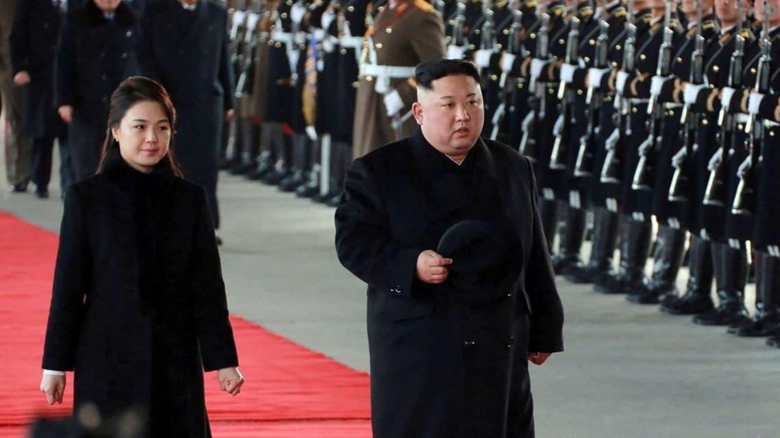 زعيم كوريا الشمالية وزوجته ري سول جو