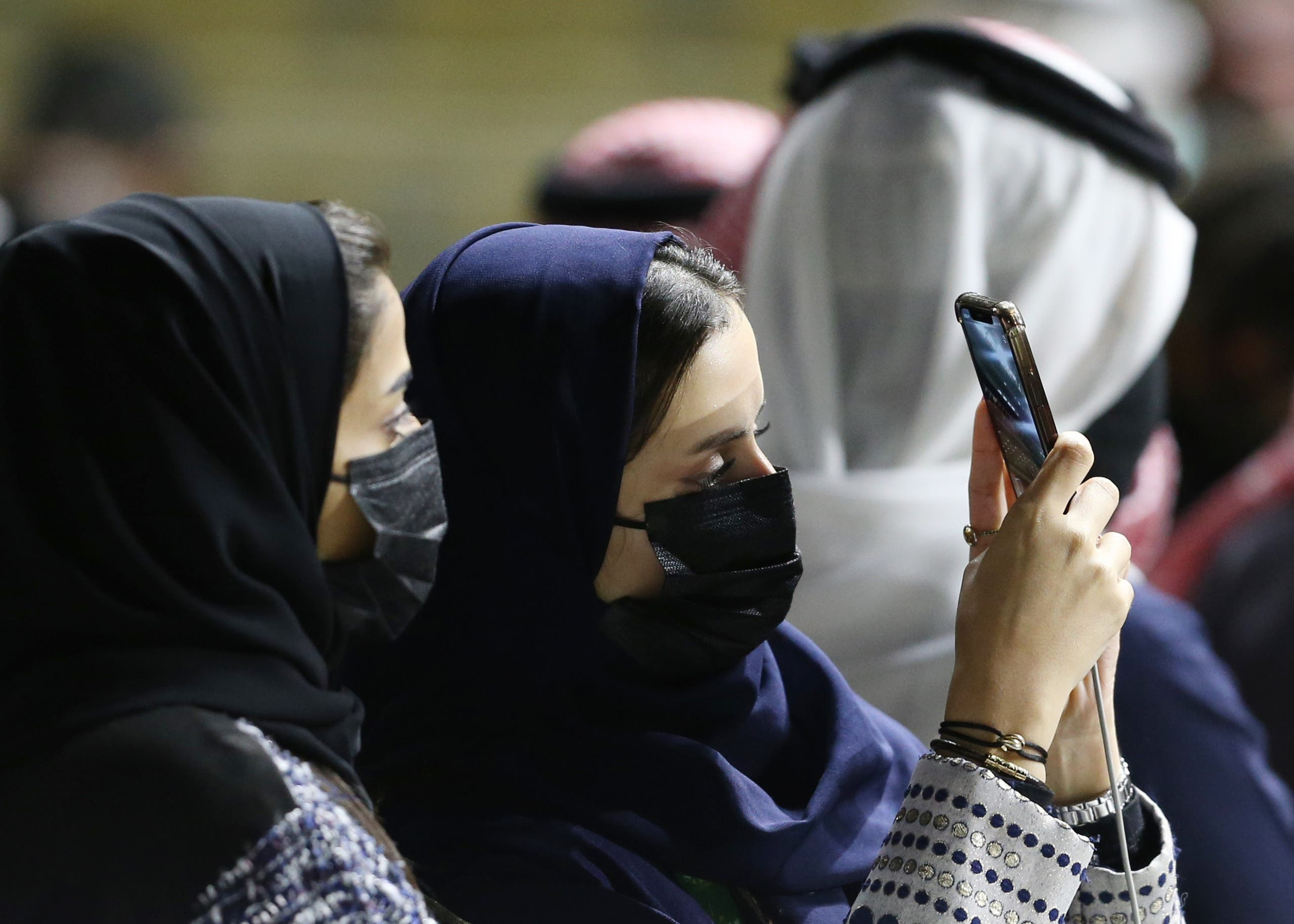 Spectators at the racetrack take a selfie. (Reuters)