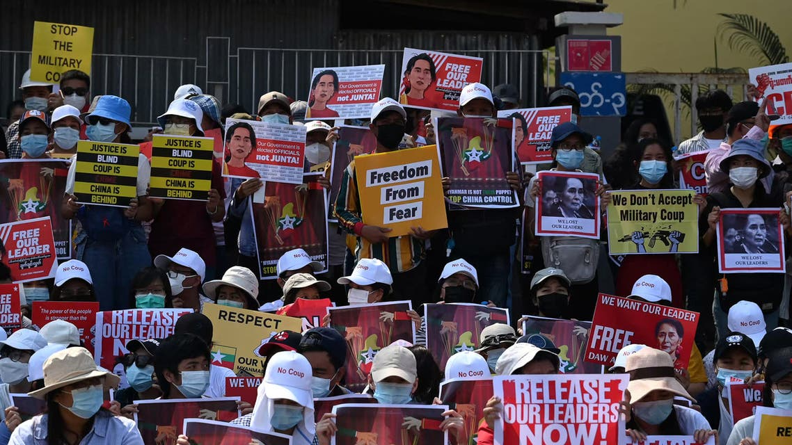Protesters hold up signs during a demonstration against the military coup in Yangon on February 20, 2021. (File photo: AFP)