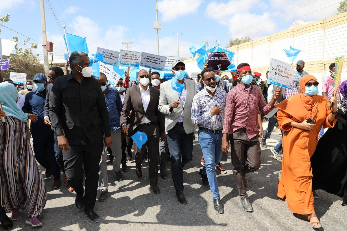 Supporters of different opposition presidential candidates demonstrate in Mogadishu on February 19, 2021. (AFP)