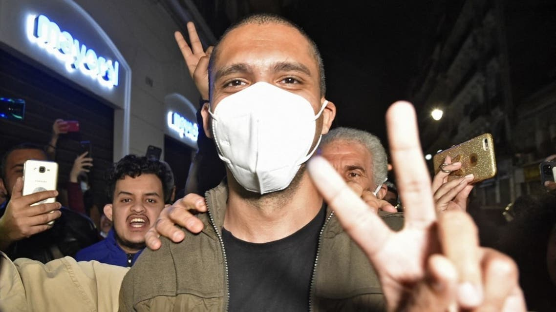 Algerian journalist Khaled Drareni is greeted by supporters upon his arrival to his home in his capital Algiers, following his release from the Kolea prison, on February 19, 2021. (AFP)