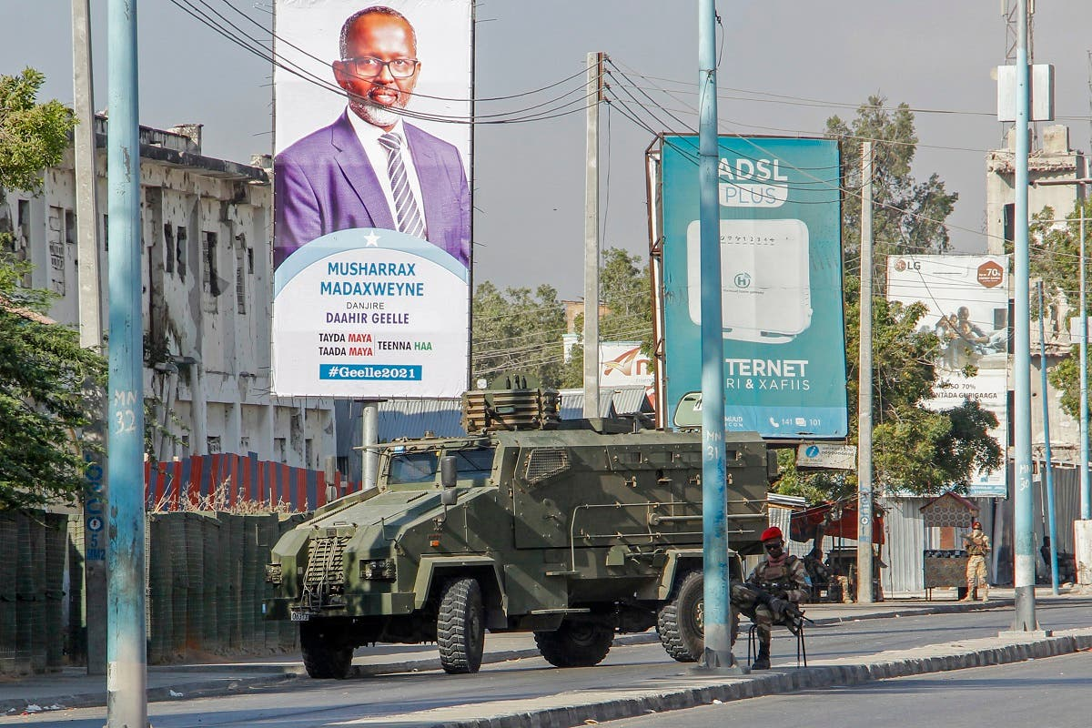 Security forces block a street with an armored personnel carrier during protests against the government and the delay of the country's election in the capital Mogadishu, Somalia, Feb. 19, 2021. (AP)