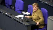 Watch: Angela Merkel panics after forgetting mask on lectern following speech