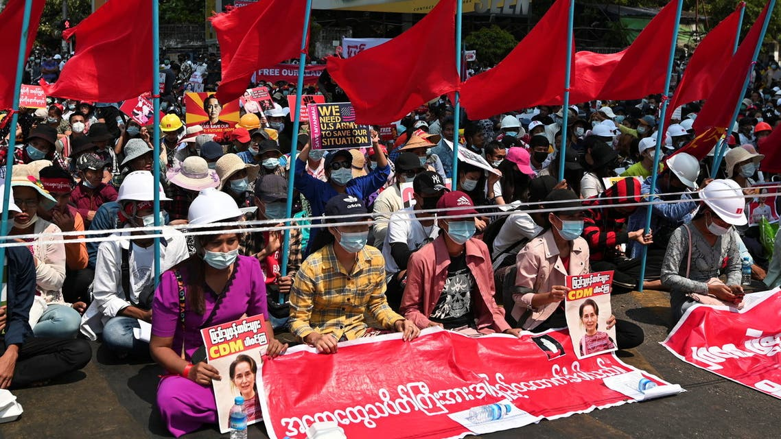 People take part in a protest against the military coup, in Yangon. (Reuters)