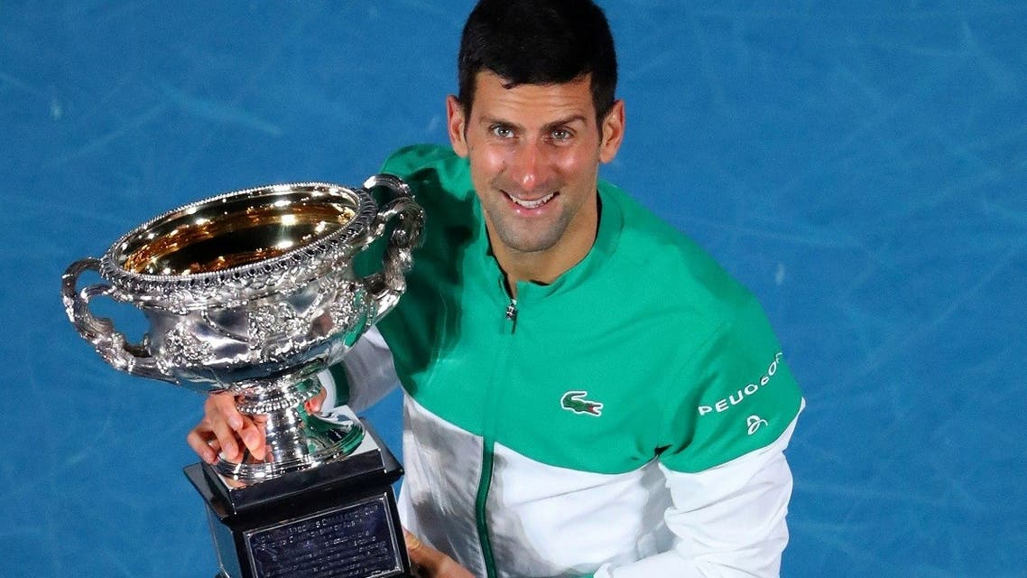 Serbia's Novak Djokovic celebrates with the trophy after winning his final match against Russia's Daniil Medvedev. (Reuters)