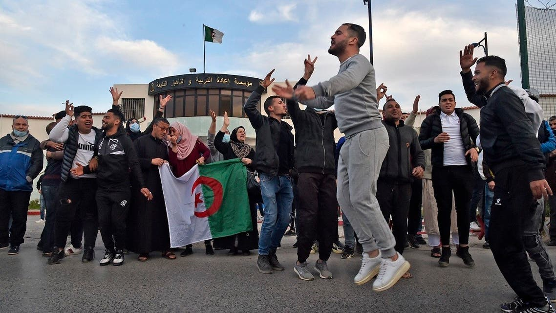 Algerians gather outside the Kolea prison, west of the capital Algiers, on February 19, 2021, after the announcement that a dozen pro-democracy activists are set to be released. (Ryad Kramdi/AFP)