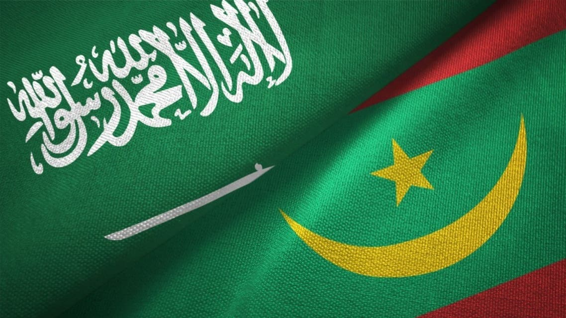 Mauritania and Saudi Arabia two flags together textile cloth, fabric texture stock photo