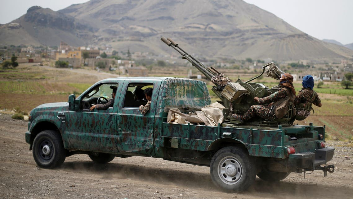 Houthi fighters man a machine gun mounted on a military truck as they parade during a gathering of Houthi loyalists on the outskirts of Sanaa. (File photo: Reuters)