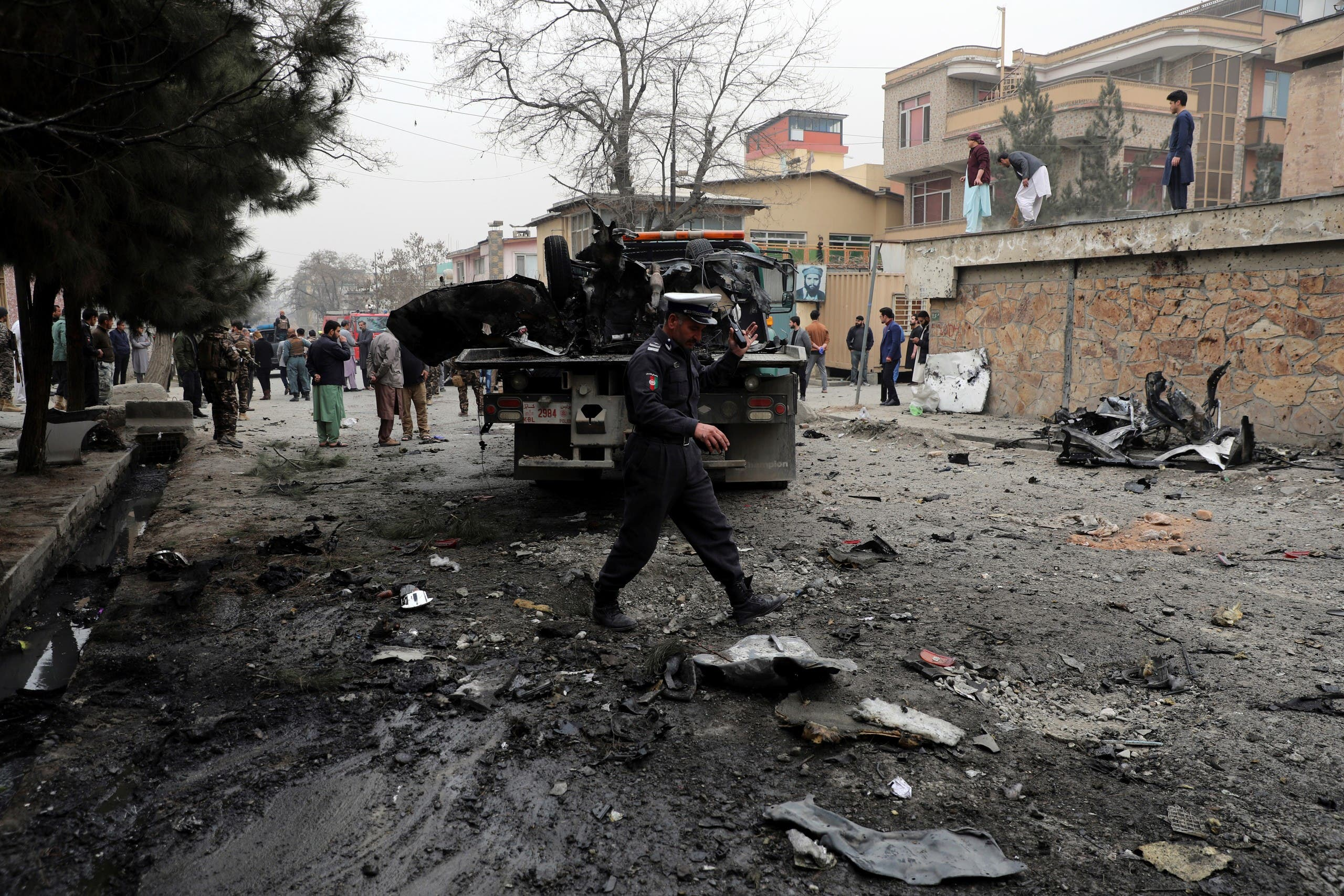 Security personnel inspect the site of a bomb attack in Kabul, Afghanistan, Saturday, Feb. 20, 2021. Three separate explosions in the capital Kabul on Saturday killed and wounded numerous people an Afghan official said. (AP)