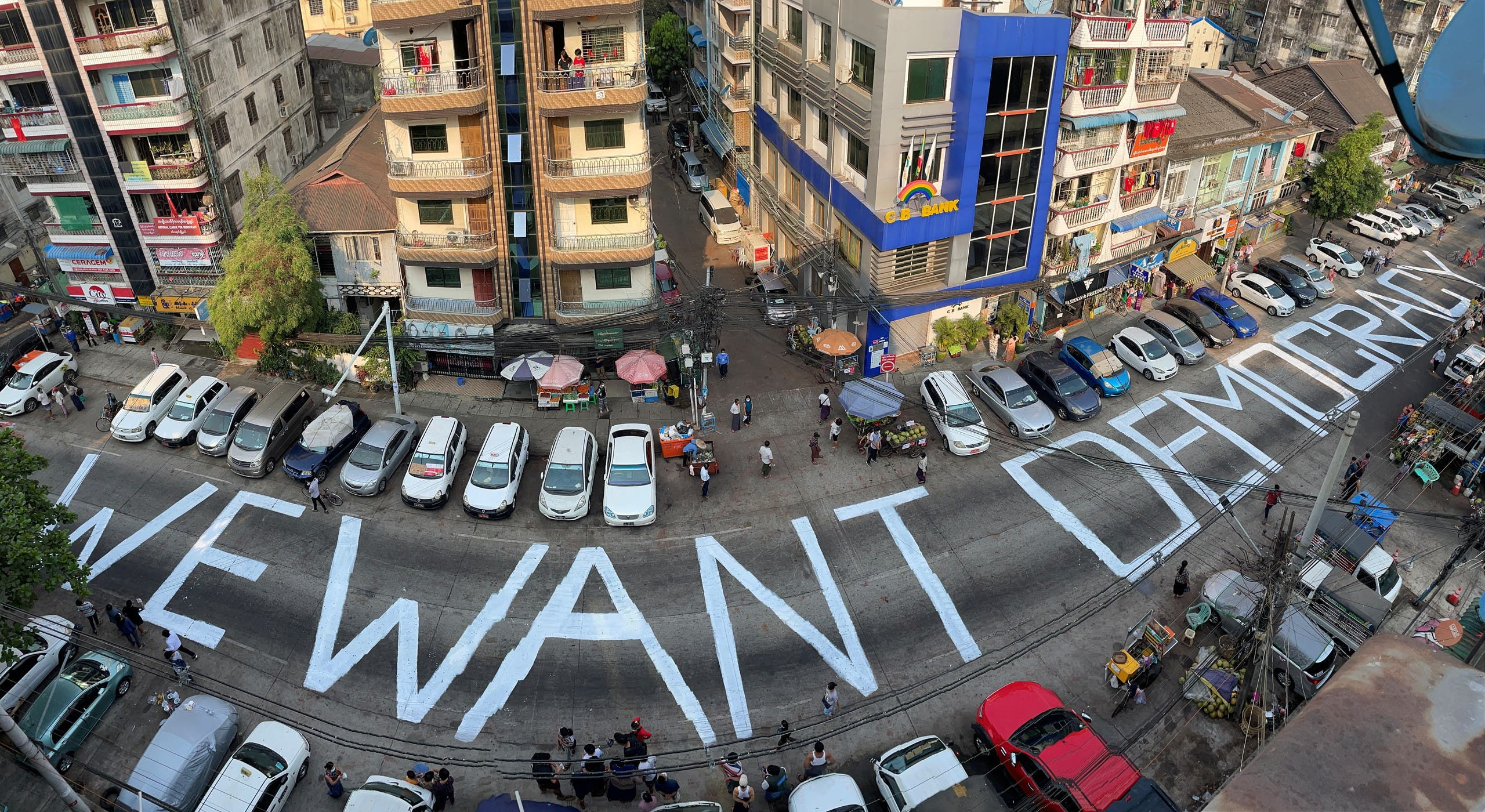 A slogan is written on a street as a protest after the coup in Yangon. (Reuters)
