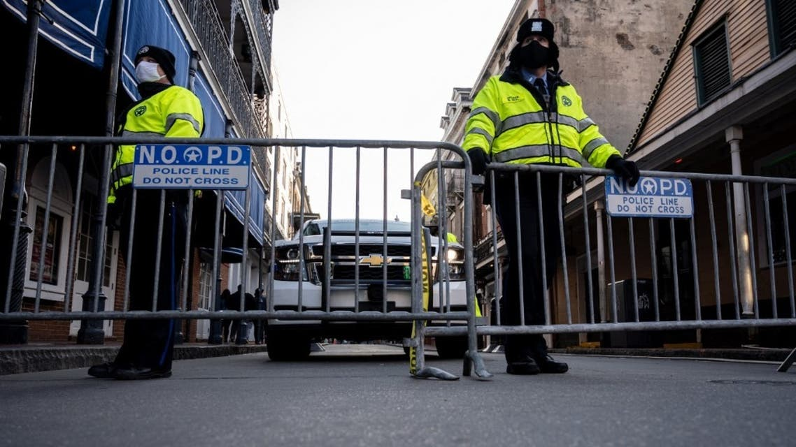 A pair of New Orleans Police Department officers guard a barricade on Bourbon Street on February 16, 2021 in New Orleans, Louisiana. (File photo: AFP)