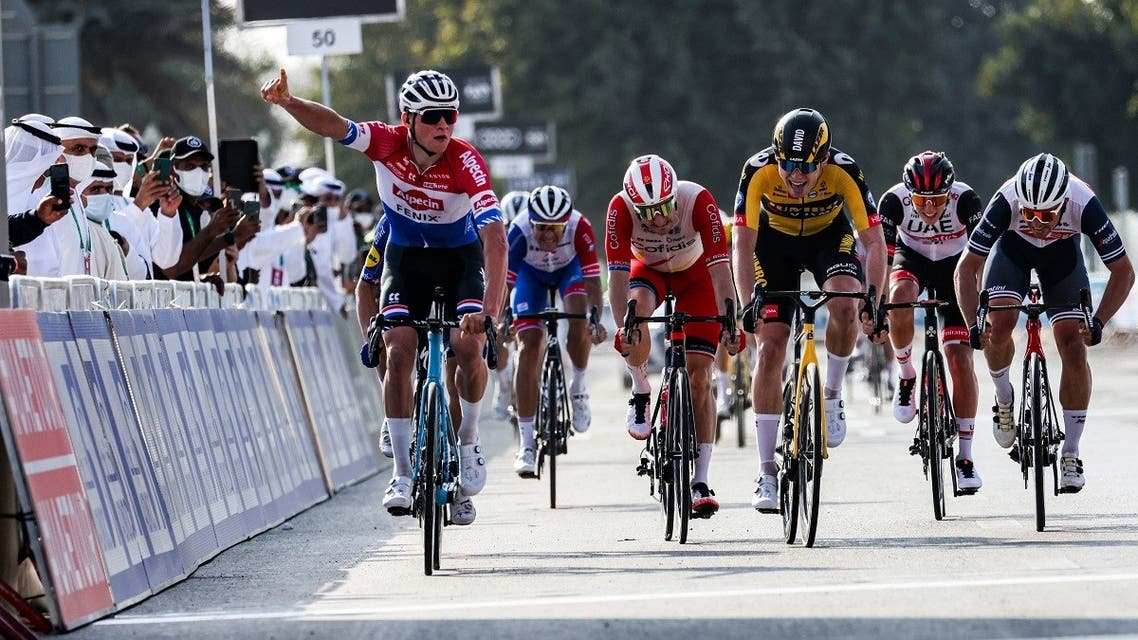 Dutch cyclist Mathieu van der Poel (L) of Team Alpecin–Fenix gestures as he approaches the finish line to win the first stage of the UAE Cycling Tour from al-Dhafra Castle to al-Mirfa on February 21, 2021.  (Giuseppe Cacace/AFP)