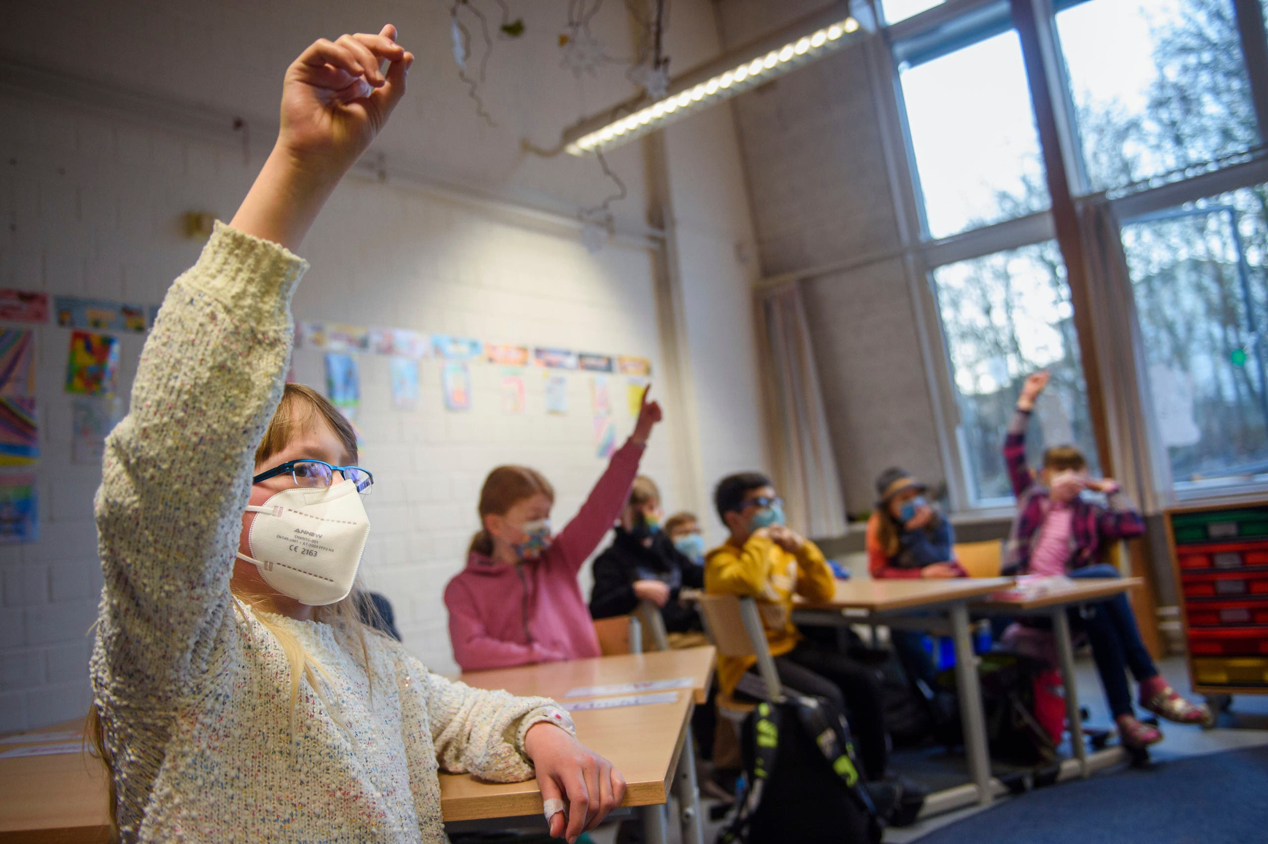 Pupils attend a lesson at the 'Russee' elementary school in Kiel, northern Germany, Monday, Feb. 22, 2021. (AP)
