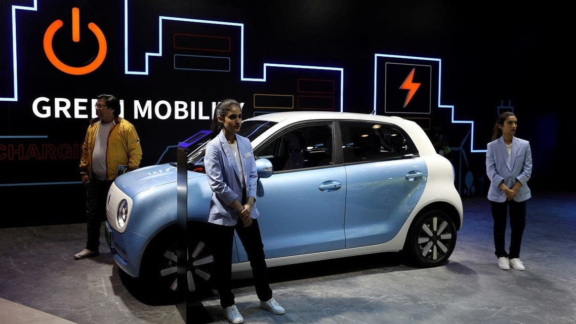 Models pose next to Great Wall Motors (GWM) GWM R1 electric car at its pavilion at the India Auto Expo 2020 in Greater Noida, India, on February 5, 2020. (Reuters)