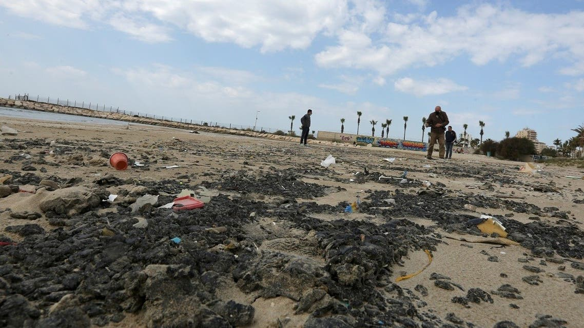 Tar is seen on the beach in the aftermath of an oil spill that drenched much of the Mediterranean, in Tyre nature reserve, Lebanon February 22, 2021. (Reuters/Aziz Taher)