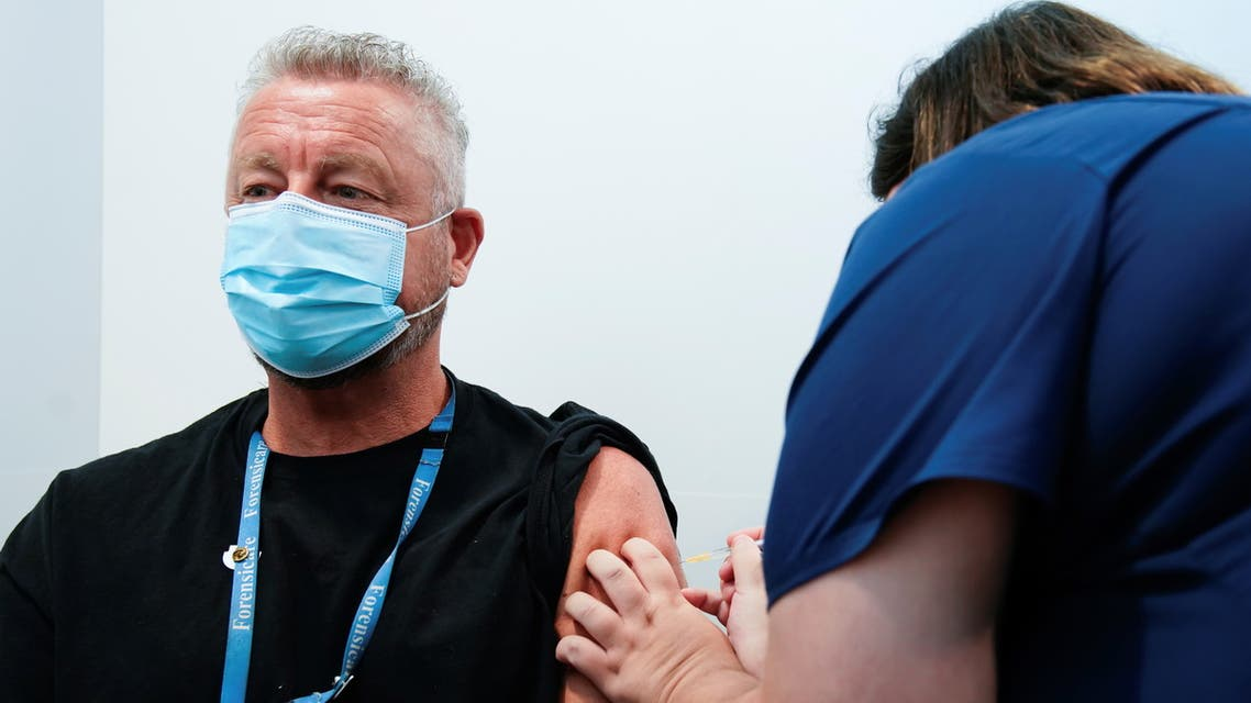 The Pfizer COVID-19 vaccine is administered to a high-risk worker in Melbourne. (Reuters)