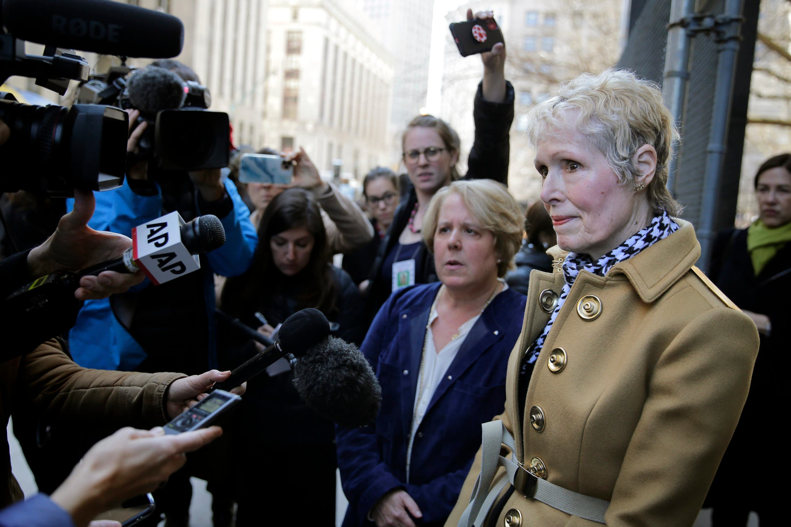 E. Jean Carroll, right, talks to reporters outside a courthouse in New York, Wednesday, March 4, 2020. (AP)