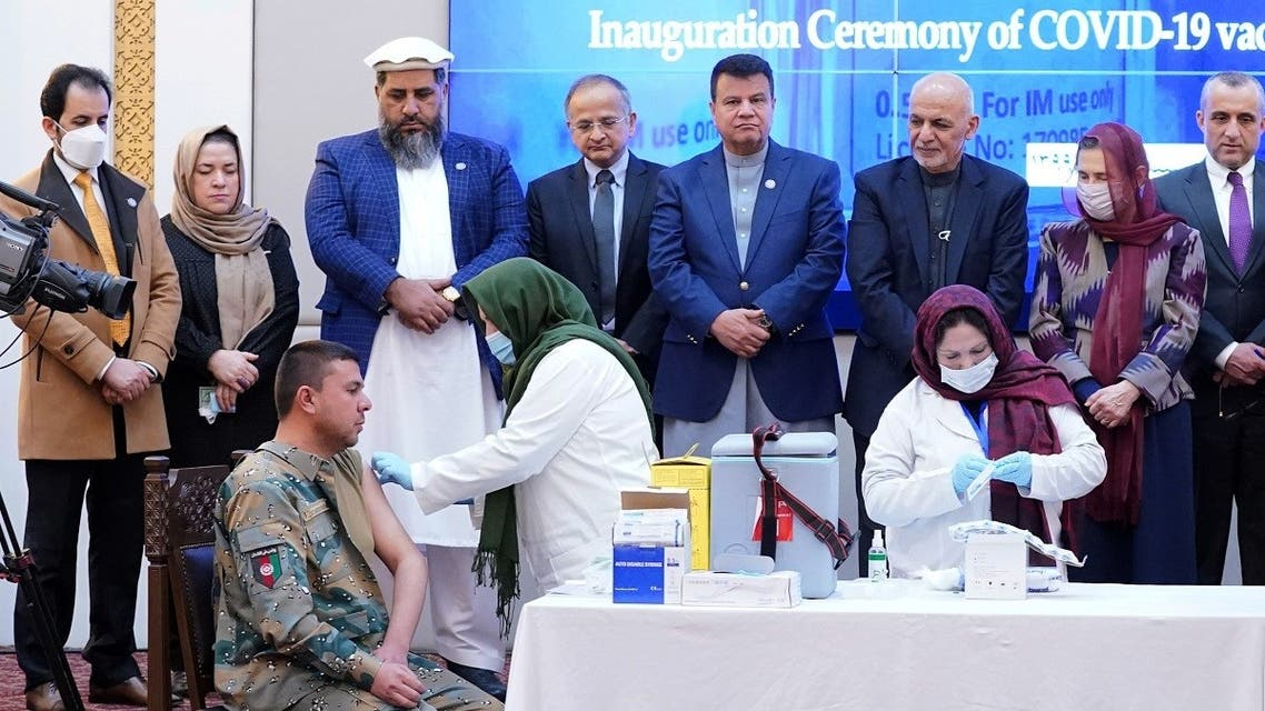 Members of Afghan security forces receive the first dose of AstraZeneca's COVID-19 vaccine from India, during a ceremony at the presidential palace in Kabul, Afghanistan, on February 23, 2021. (Reuters)