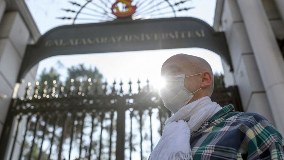 A French teacher from the Galatasaray University stands during a protest in support to French teachers without working permits in front of Galatasaray university in Istanbul on February 23, 2021. (AFP)