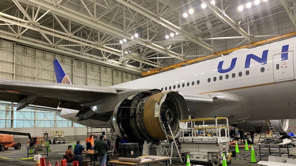 The damaged starboard engine of United Airlines flight 328, a Boeing 777-200, is seen following a February 20 engine failure incident, in a hangar at Denver International Airport in Denver, Colorado, US, on February 22, 2021. (Reuters)