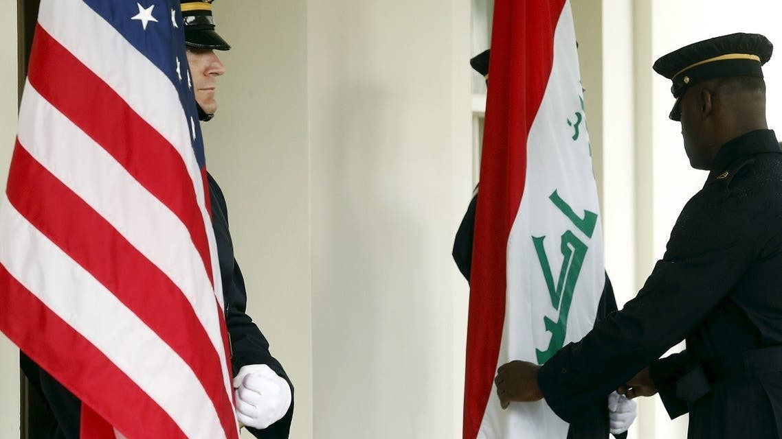 Military honor guards dress the US and Iraqi flags in Washington at the White House. (File Photo: Reuters)