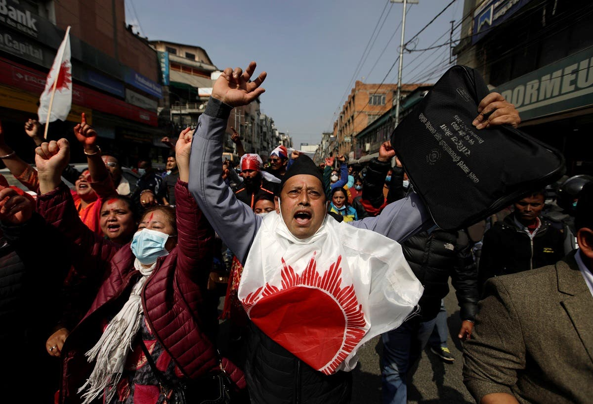 Supporters of a faction of the ruling Nepal Communist Party take part in a rally celebrating the reinstatement of the parliament by Nepal's top court in Kathmandu, Nepal, on February 24, 2021. (Reuters)