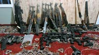 کشف جنگ افزار ایرانی و لباس نظامی سپاه از قرارگاه طالبان در هرات