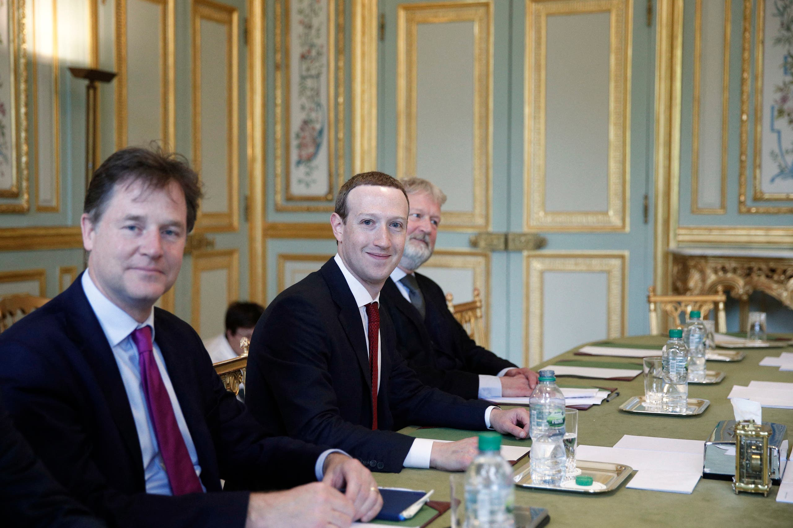 CEO and co-founder of Facebook Mark Zuckerberg poses next to Facebook head of global policy communications and former UK deputy prime minister Nick Clegg (L). (AP)