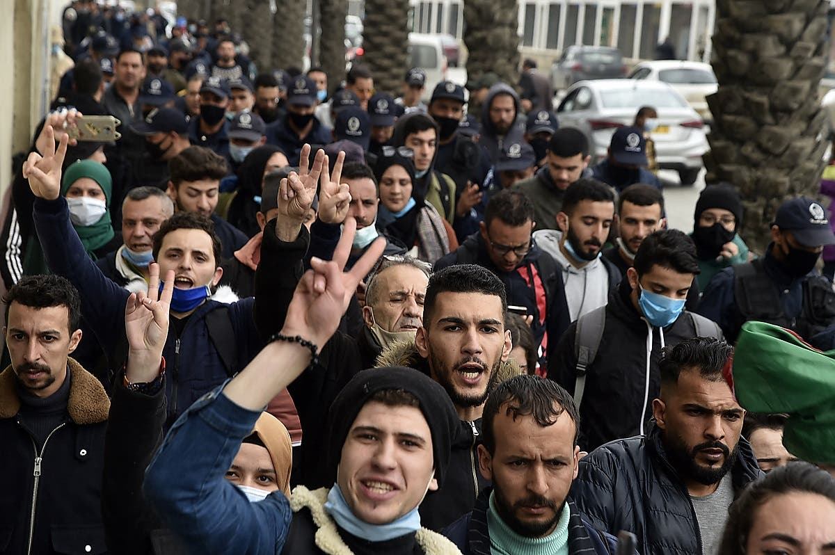 Policemen are seen on the sidelines as students chant slogans while demonstrating in the center of Algeria's capital Algiers on February 23, 2021. (File photo: AFP)