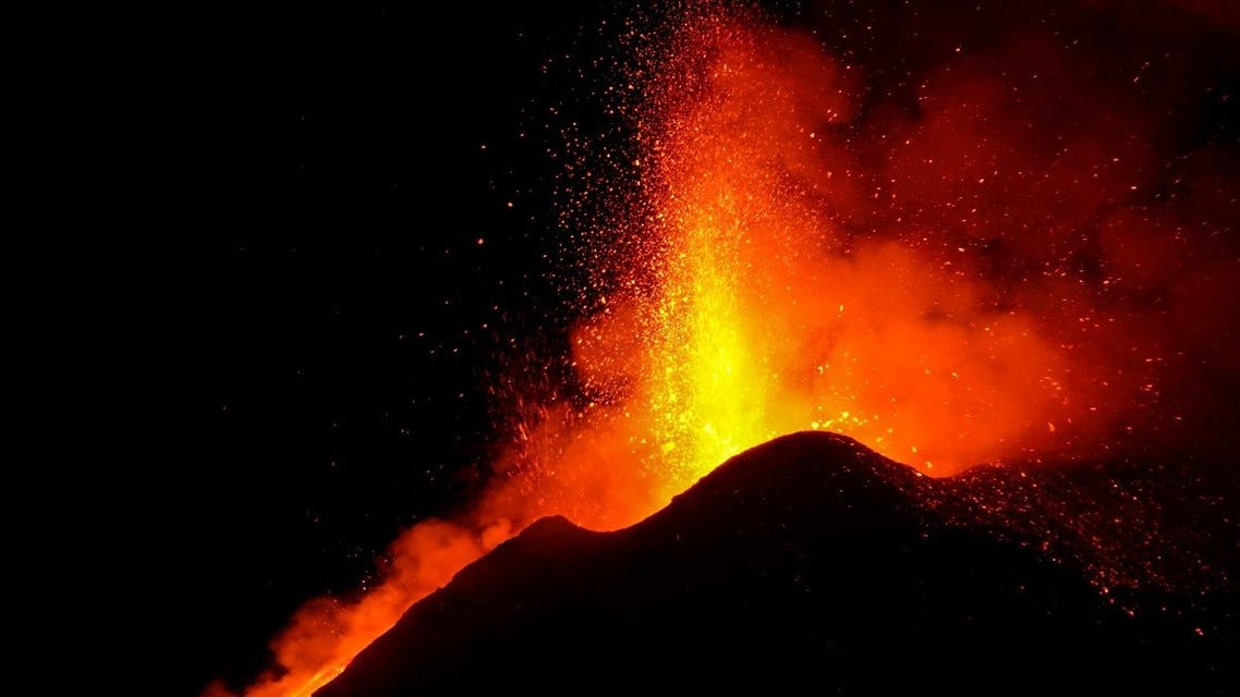 Large streams of red hot lava shoot into the night sky as Mount Etna, Europe's most active volcano, continues to erupt, , as seen from the village of Fornazzo, Italy, on February 22, 2021. (Reuters)