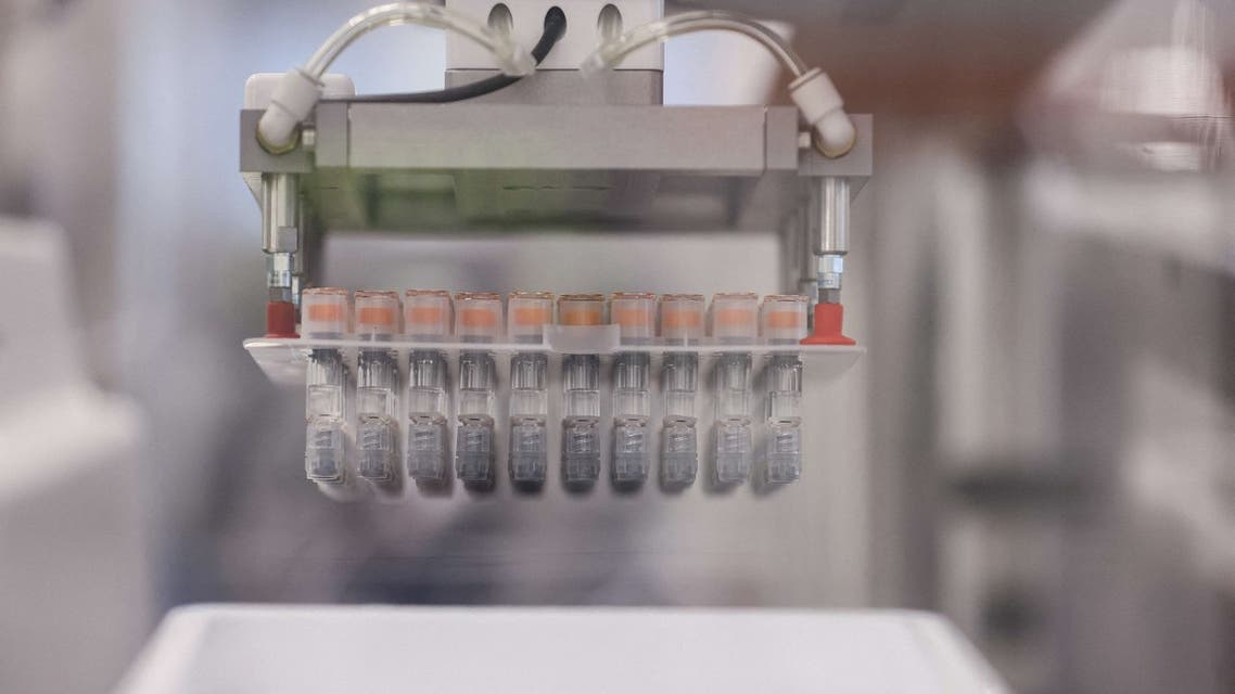Vials are seen on a packing line at the factory of British pharmaceutical company GlaxoSmithKline (GSK) in Wavre on February 8, 2021 where the Covid-19 CureVac vaccine will be produced. (File photo: AFP)