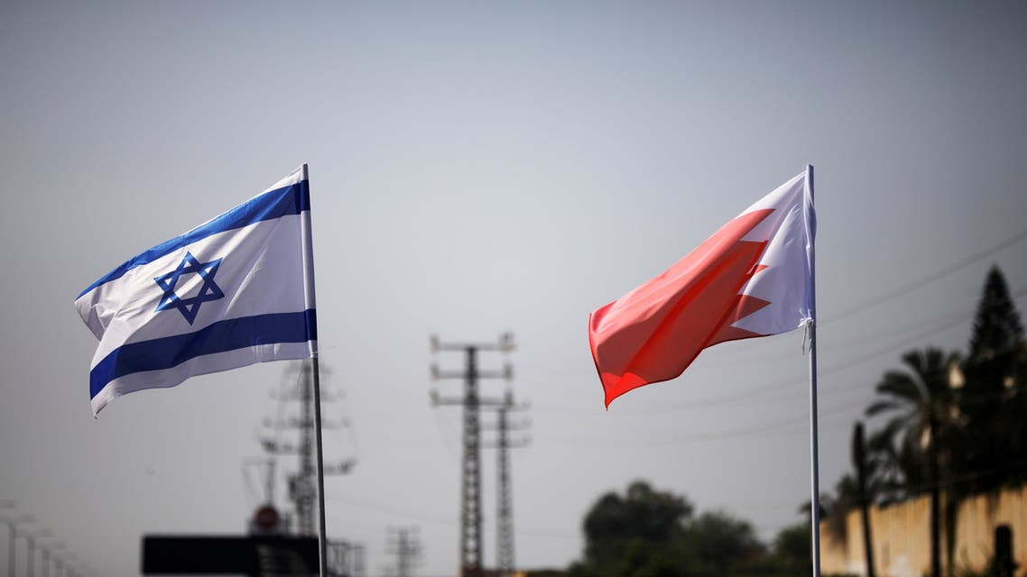 The flags of Israel and Bahrain flutter along a road in Netanya. (Reuters)