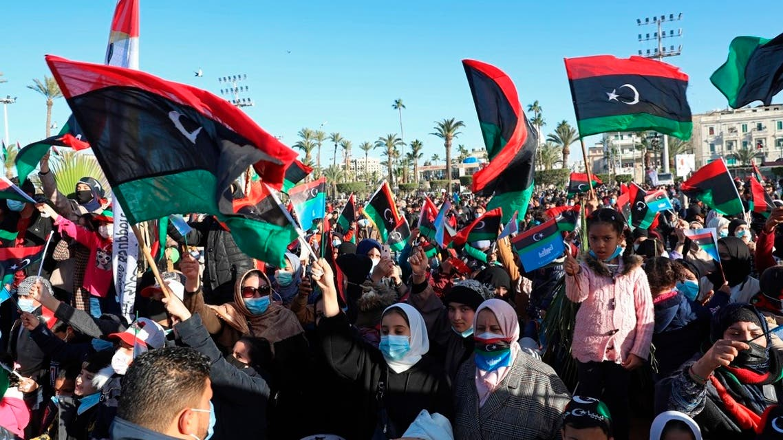 Libyans mark the 10th anniversary of their 2011 uprising that led to the overthrow and killing of longtime dictator Moammar Gadhafi in Martyrs Square, Tripoli. (AP)