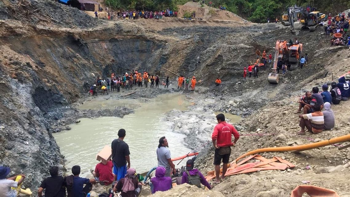 Rescue teams conduct a search for miners buried by a landslide at an illegal gold mining operation in the village of Buranga in Parigi Moutong Regency, Central Sulawesi on February 25, 2021. (AFP)