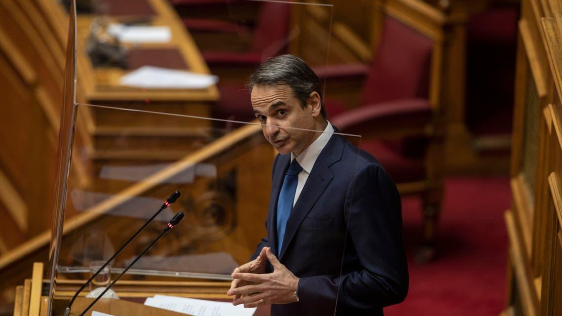 Greek Prime Minister Kyriakos Mitsotakis speaks during a parliamentary session in Athens, Thursday, Feb. 25, 2021. (AP)