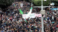 Thousands defy Algeria's COVID-19 curfew in pro-democracy protests