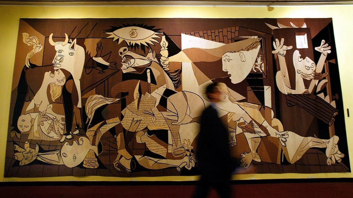 A man walks by Spanish artist Pablo Picasso's 'Guernica' at the United Nations headquarters in New York August 10, 2005. (Reuters)